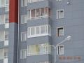 Теплый ПВХ-балкон и ламинированное окно со шпросами
