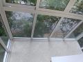 Застекленный балкон с раздвижными створками